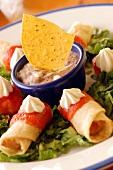 Flautas (crispy Mexican tortilla rolls) with dip