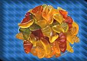 Bowl of wine gums on bluish background
