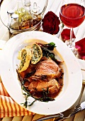 Two slices of roast leg of lamb and potato and chard strudel
