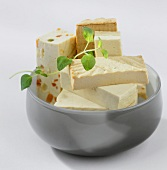 Various types of tofu in a bowl