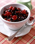 Red fruit compote in a white bowl