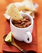 Chili con carne, served in a cup