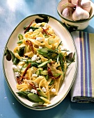 Ribbon pasta with asparagus, tomatoes and sheep's cheese
