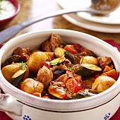 Beef goulash with vegetables in a soup tureen