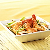 Three jumbo prawns with ginger and Asian vegetables