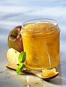 Apple preserve in jar and on spoon