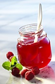 Raspberry jelly in a jar