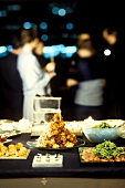 Party buffet with various dishes