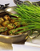 Liver dumpling soup with chives