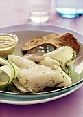 Graved halibut with cucumber slice and dip