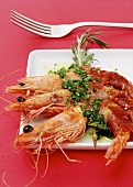 Gamberi in coperta (King prawns wrapped in Parma ham)