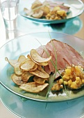 Ham with sweet potato crisps and aubergine chutney