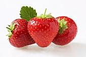 Three red strawberries