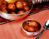 Gulab jamuns - deep-fried Indian milk balls in syrup