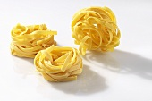 Three ribbon noodle nests