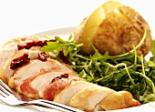 Chicken breast wrapped in bacon with rocket salad & potato