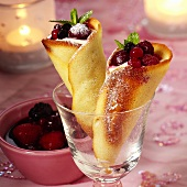 Baked wafer cones filled with berries and mousse
