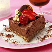 Piece of chocolate mousse gateau with strawberries