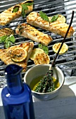 Pieces of halibut with lime and bay leaf marinade on barbecue
