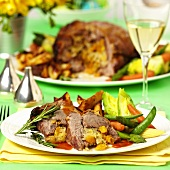 Roast lamb with pumpkin and carrot stuffing & vegetables