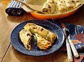 Baked pancake rolls with spinach filling