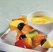 Smoked salmon and fruit kebabs with curried orange mousse