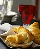 Croissant sandwich with salmon mousse on a party tray