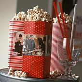 Popcorn in paper bags with cinema motifs