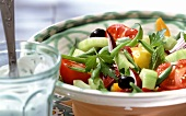 Colourful vegetable salad with minted yoghurt dressing