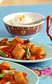 Sweet and sour fish in batter, with rice and peanuts