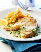 Fried cod cutlet with herb sauce and pumpkin puree