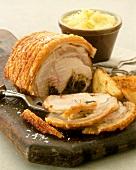 Stuffed pork roll on a wooden board