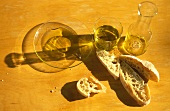 Olive oil tasting - glass, carafe, plate and ciabatta