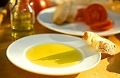 Olive oil tasting - plate with oil and ciabatta for tasting
