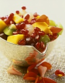 Fruit salad with exotic fruit and rose petals