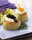 Potato cakes with crème fraiche and caviare