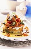 Potato cakes with crème fraiche, vegetables & smoked salmon