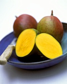 Mangos, one cut open