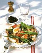 Smoked fish salad with vegetables, bread and egg