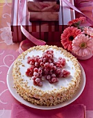 Redcurrant yoghurt cake with peanuts
