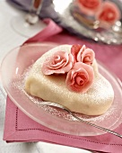 Heart-shaped cake with marzipan coating and marzipan roses