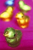 Small colourfully wrapped chocolate chickens