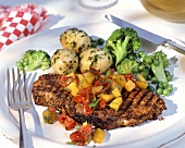 Barbecued neck chop with tomato & pepper salsa & vegetables