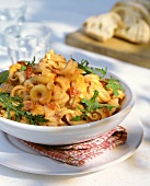 Pasta with tomato cream sauce, bacon, chicken and rocket