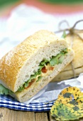 Bread roll sandwich with lettuce & hummus (chick-pea paste)