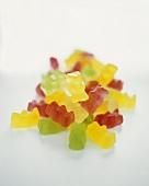 Gummi bears on a sheet of glass