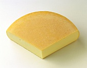 A quarter of a raclette cheese