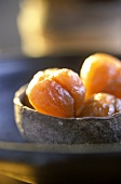 Terracotta bowl of candied sweet chestnuts