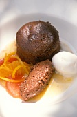 A small chocolate cake, mousse au chocolat and lemon sorbet