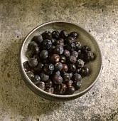 Juniper berries in an iron bowl